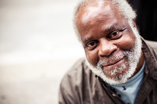 Close of african american man smiling with a grey beard